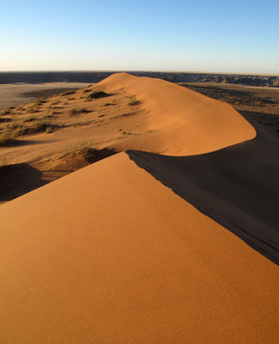 hiking on big daddy dune in the namib desert in namibia